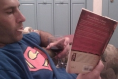 This isn't superman inspire of his t-shirt. It's my boss. He is on vacation and reading my book.